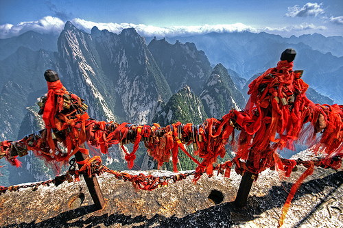 Ribbons and locks at one of the peak of Hua Shan, a sacred Daoist mountain. The ribbons represent good luck and it is traditional to have the locks inscribed with the name of a loved one or with a personal wish, then throw the key over the cliff as a symbol that the prayer is locked in the sacred mountain. Courtesy of &lt;a href=