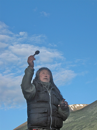 Danil Mamyev makes an offering before heading out onto the Ukok Plateau. © 2010 Christopher McLeod